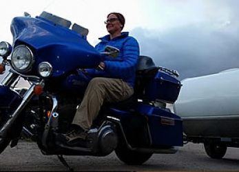 Woman Motorcycle Rider Opts for Life on Harley-Davidson with Trailer in Tow